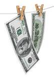 Pengar på ett rep Fotografering för Bildbyråer