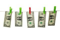 Pengar på ett rep arkivfoto