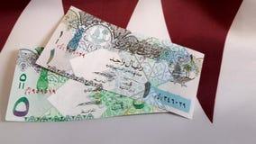 Pengar på flagga av Qatar lager videofilmer