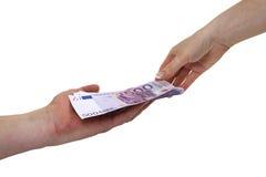 Pengar på händerna Arkivfoto