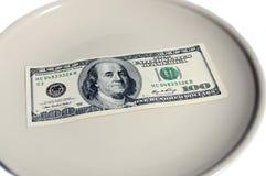 Pengar på plattan Fotografering för Bildbyråer