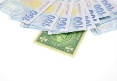 Pengar på vitbakgrund arkivfoton