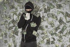 Pengar regnar på ficktjuven Arkivbild