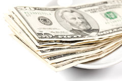 pengar som betalar plattan Fotografering för Bildbyråer