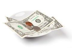 pengar som betalar plattan Royaltyfri Bild