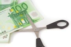 Pengar som klipper den finansiella besparingbudgeten Fotografering för Bildbyråer