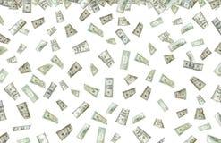 pengar som regnar s Arkivfoton