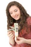 pengar som visar kvinnabarn arkivbilder