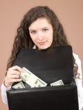 pengar som visar kvinnabarn royaltyfri bild