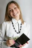 pengar som visar kvinnan Arkivfoto