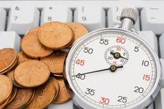 pengar sparar tid Arkivbild