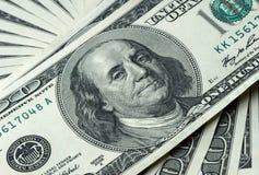 Pengar till amerikanska dollar Arkivfoto