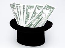 Pengar vid magisk konst Royaltyfri Bild