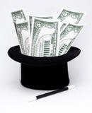 Pengar vid magisk konst arkivbild