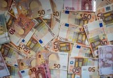 Pengarbakgrund, eurosedlar stänger sig upp Arkivfoto