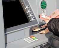 Pengarbankomat arkivbilder