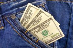 Pengardollar i facket av jeans Fotografering för Bildbyråer