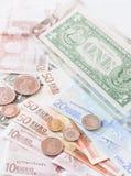 Pengareurosedlar, mynt och oss sedlar Fotografering för Bildbyråer
