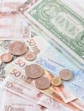 Pengareurosedlar, mynt och oss sedlar Royaltyfri Fotografi