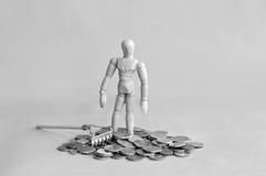 Pengarmannen med krattar Arkivfoto