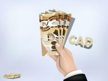 Pengarpapper för kanadensisk dollar förestående, kassa förestående Arkivbilder