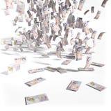 Pengarregn av 10 pund ett pund sterlingräkningar Royaltyfri Fotografi