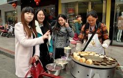 Penghou, China: Girls Buying Street Food Stock Photo