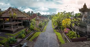 Straight Street in Penglipuran Village, Bali Aga. Penglipuran is a traditional balinese village at Bangli Regency with Bale Bengong for meeting pavilion and stock image