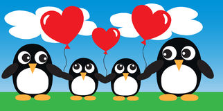 Μια γλυκιά οικογένεια penguin με τα μπαλόνια Στοκ Εικόνες