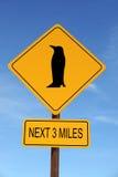 Penguin Ahead warning roadsign. Yellow Penguin Ahead warning roadsign over blue sky royalty free stock photos