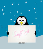 Penguin with blank sign. Royalty Free Stock Image