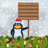 Penguin with blank wooden sign Royalty Free Stock Images