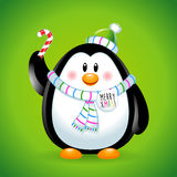 Penguin boy in Christmas with candy. Green Royalty Free Stock Photo