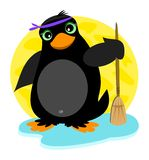 Penguin and Broom Royalty Free Stock Photography