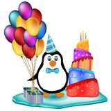 Penguin with cake, balloons and cake Royalty Free Stock Photography