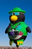 Penguin with camera hot air balloons Stock Photos