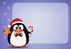 Penguin with candy cane Royalty Free Stock Images