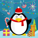 Penguin with Candy Stick Near Christmas Presents Stock Photography