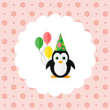 Penguin in the cap and with balloons Royalty Free Stock Photo