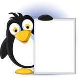 Penguin cartoon with blank sign Royalty Free Stock Photos