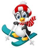 Penguin cartoon skiing Royalty Free Stock Photo
