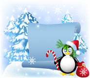Penguin with Christmas candy in the forest Stock Photography