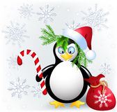 Penguin with Christmas candy. Red bag and Santa hat Royalty Free Stock Photography
