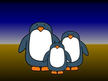 Penguin couple 1 child Royalty Free Stock Photo