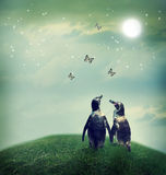 Penguin couple in fantasy landscape. Two penguin friendship or love theme image at a fantasy landscape Royalty Free Stock Image
