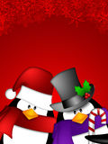 Penguin Couple on Red Snowflakes Background Royalty Free Stock Image