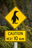 Penguin Crossing. A penguin crossing sign on the road in New Zealand Stock Photo