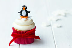 Penguin cupcake. With copy space to side Royalty Free Stock Image