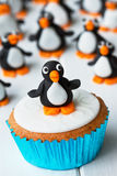 Penguin cupcake. Cupcake decorated with a sugar penguin Stock Photos