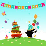 Penguin Delivering Birthday Cake Royalty Free Stock Photo
